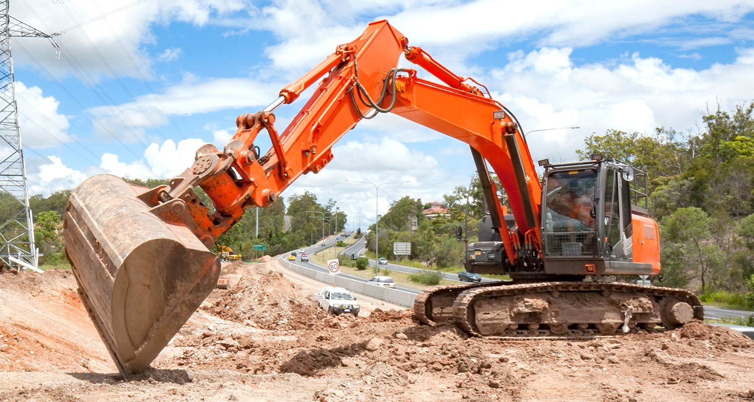 an excavator digging a hole