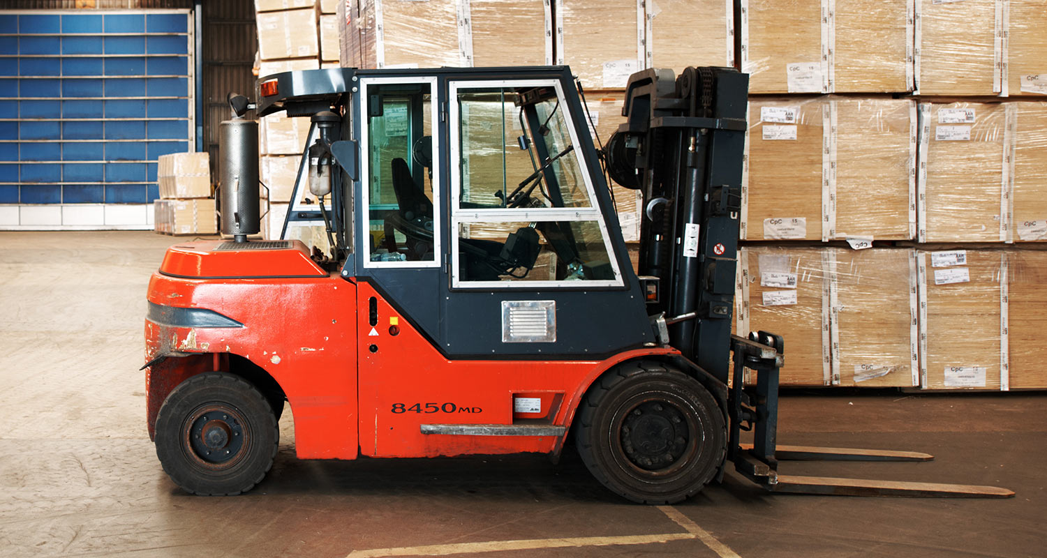 a forklift near boxes in a warehouse