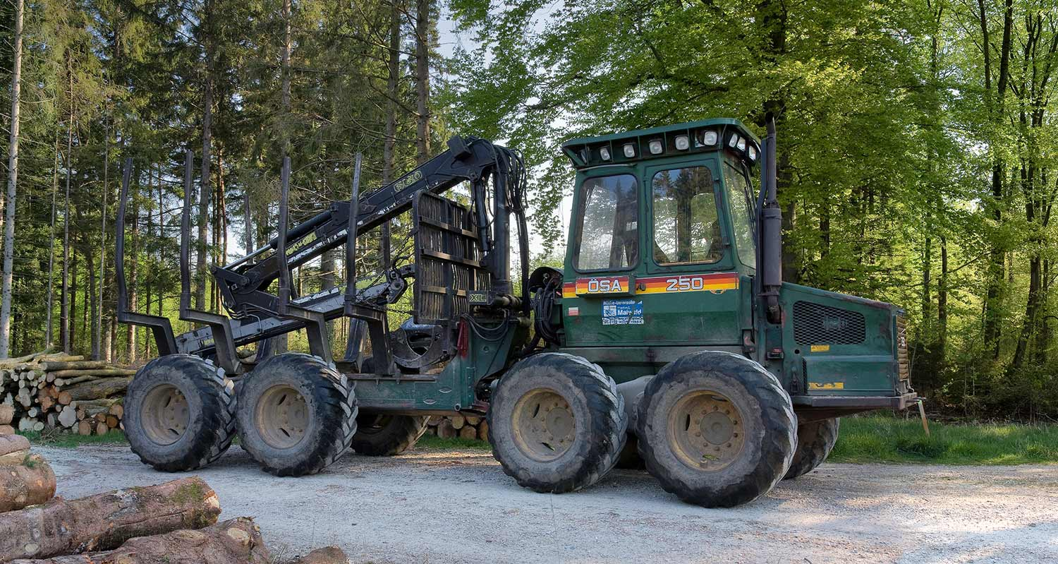 a forwarder at the edge of a forest