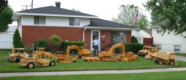 Man Outfits Lawn with Custom Heavy Equipment Models