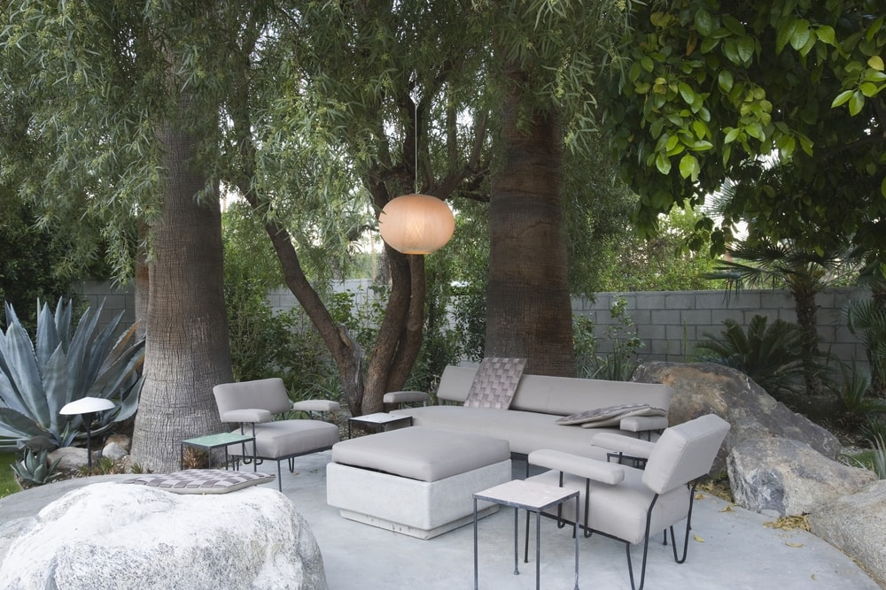 ... Hung From A Tree Branch Makes This Very Whimsical While The Gray Tones  Of The Furniture Matching The Floor And Rock Features Help Keep With Patio  Zen.