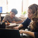 Mother homeschooling teenage boys