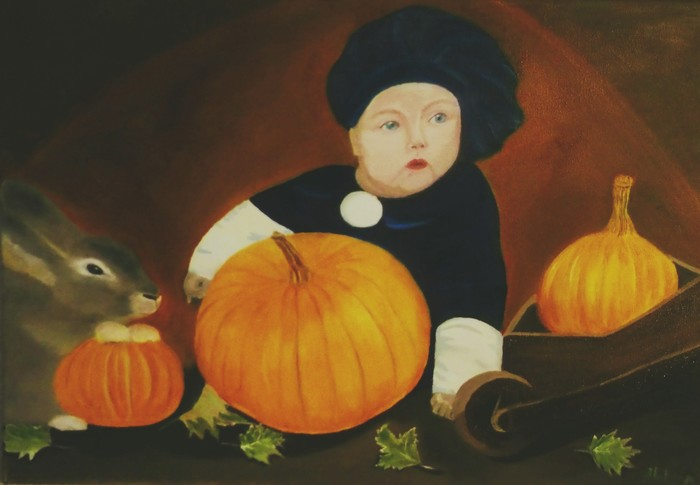 The paj-boy with a rabbit and pumpkins.