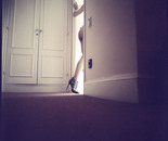 Young lady goes through door