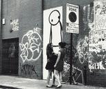 London women with stick man