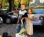 Moldovan children earn money for school. Street vendors of corn.