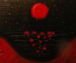 A Red Moon Over An Ocean