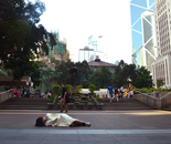 Sleeping on the ground with a quilt at Statue Square, Central