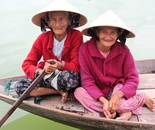Two Vietnamese ladies rowing