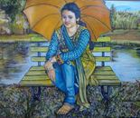 Girl seated with umbrella