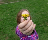 Photograph of a girl holding a flower