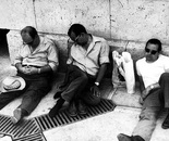Three exhausted men at the Arc de Triomphe, Paris, France, 1976