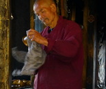 Monk Polishing Brass Bells