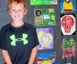 "Natalya B. Parris's student with his art at art exhibit and reception on June 19, 2015 for ""Exploring The World Through Art"" Arts Barn Camp June 16 - 19, 2015"