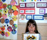 Student with her artwork; Montgomery County Recreation Summer Fun Center in July 2015