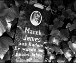 27. The memorial stone with a picture of Marek James...