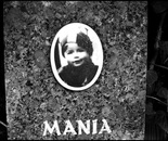32. The memorial stone with a picture of Mania Altman...