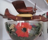 wooden plane on poppy field bowl
