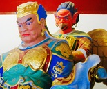bust of Gengis Khan with devil