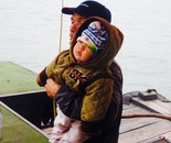 Vietnamese child & grandfather on sea