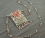 white and pink heart amulet bag