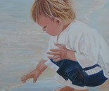a child touches the water
