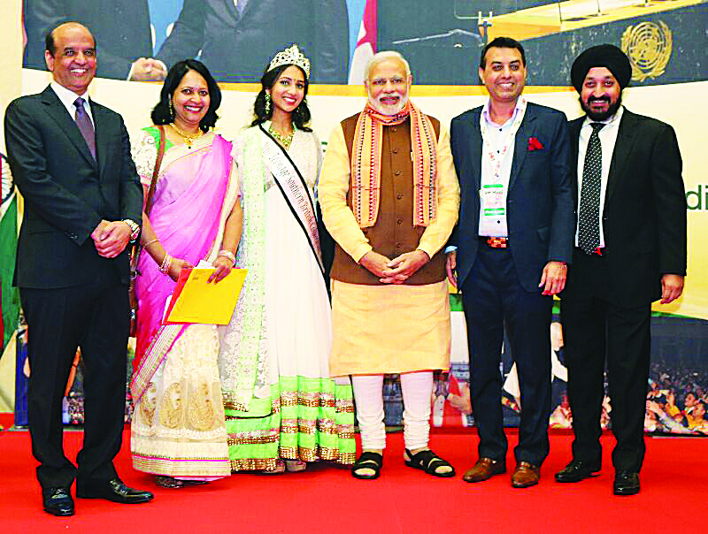 Indian Prime Minister Narendra Modi with OFBJP - BC President Aditya Tawatia, Daljit Thind, Paul Arora, and Aashritha Royyuru, past title holder for Miss Teenage Southern British Columbia with her mother. Photos: Submitted