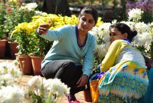 Jaipur: Girls click a `selfie` at a flower exhibition organised at Rajasthan University in Jaipur, on Dec 5, 2014. (Photo: Ravi Shankar Vyas/IANS)