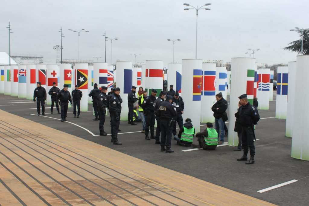 Just to handle a couple of protesters at CoP21 gate, more than a dozen policeman turn up. (Photo: IANS)
