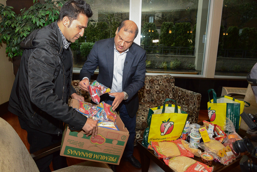 Tony SIngh Gruiticana distributing Free Groceries to Syrian refugees