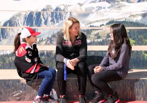 Gabriella Lee, 8 years old, and Hayley Lee, 12 years old, of the Surrey Falcons sit and talk hockey and their ideas for WickFest Surrey with Hayley Wickenheiser on the steps of Surrey City Hall.