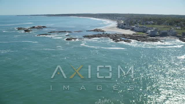 Flying by beach, upscale oceanfront homes, Scituate, Massachusetts Aerial Stock Footage | AX143_031