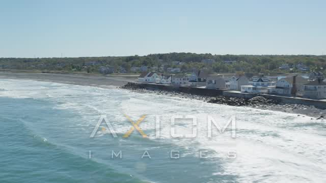 Flying by oceanfront homes, pan right, Scituate, Massachusetts Aerial Stock Footage | AX143_033
