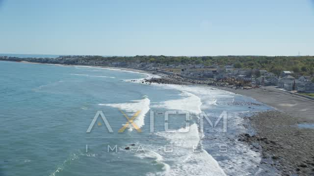 Flying by a beach, oceanfront homes, Scituate, Massachusetts Aerial Stock Footage | AX143_036