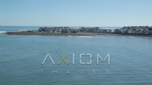 Flying low over ocean, by beach and oceanfront homes, Scituate, Massachusetts Aerial Stock Footage | AX143_038