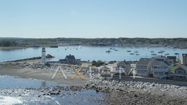 Orbiting Old Scituate Light, beach, oceanfront homes, Scituate, Massachusetts Aerial Stock Footage AX143_040