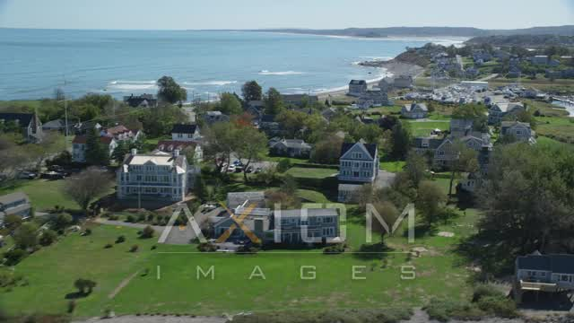 Flying by beach, oceanfront homes, Scituate, Massachusetts Aerial Stock Footage | AX143_043