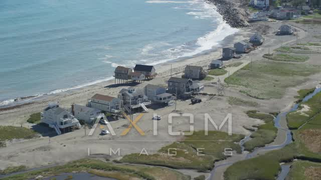 Flying by elevated oceanfront homes, Scituate, Massachusetts Aerial Stock Footage | AX143_045
