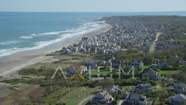 Fly over oceanfront homes, approaching coastal town, Marshfield, Massachusetts Aerial Stock Footage AX143_056