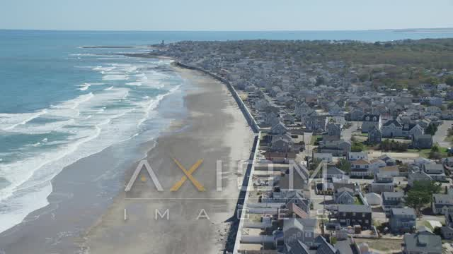 Fly over beach,  oceanfront homes, small coastal town, Marshfield, Massachusetts Aerial Stock Footage AX143_057