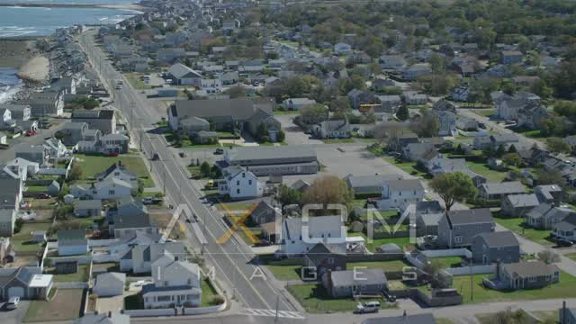 Flying by oceanfront homes, small coastal town, Marshfield, Massachusetts Aerial Stock Footage | AX143_059