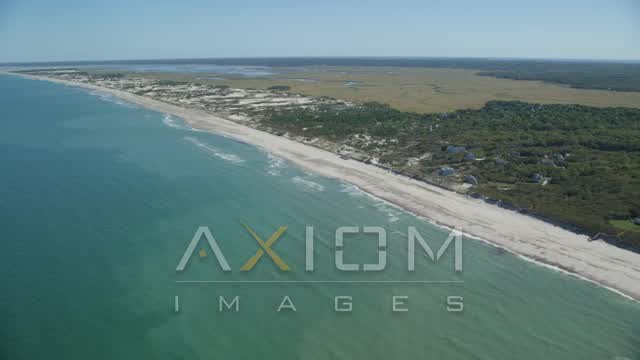 Approaching and flying over a beach, Barnstable, Massachusetts Aerial Stock Footage | AX143_131