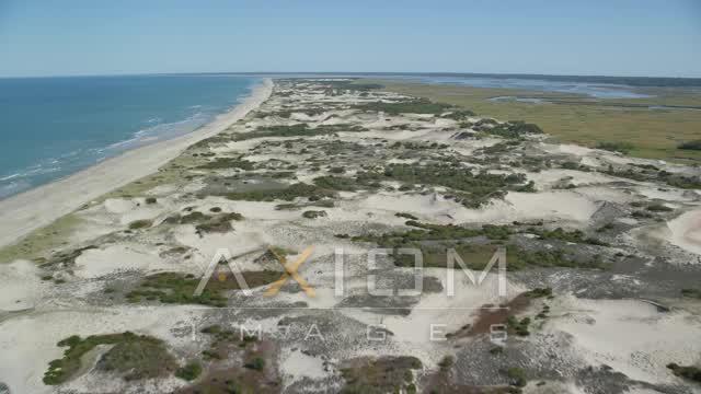 Flying over sand dunes near the beach, Barnstable, Cape Cod, Massachusetts Aerial Stock Footage | AX143_133