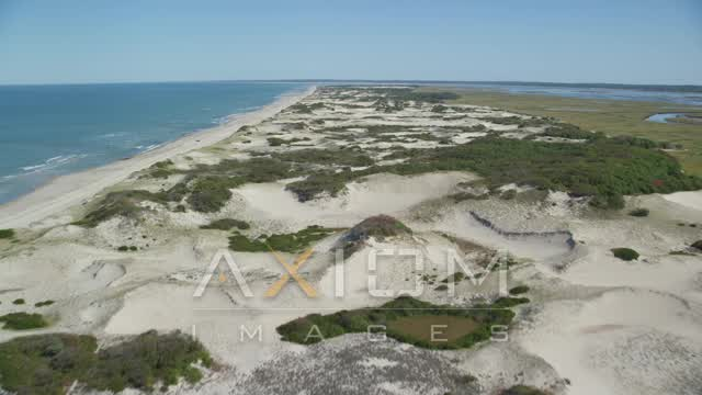 Flying over sand dunes, beach, Barnstable, Cape Cod, Massachusetts Aerial Stock Footage | AX143_134