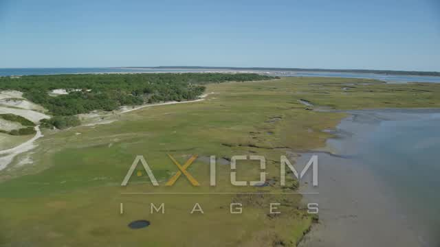 Marshland, coastal road, isolated homes, Cape Cod, Barnstable, Massachusetts Aerial Stock Footage | AX143_140