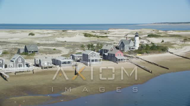 Sandy Neck Colony, Sandy Neck Light, Cape Cod, Barnstable, Massachusetts Aerial Stock Footage | AX143_144