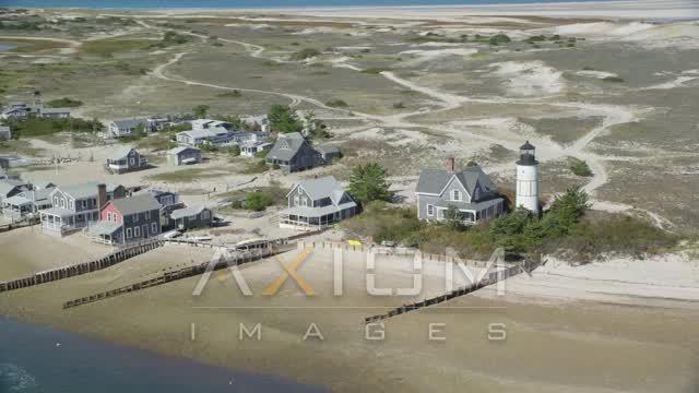 Sandy Neck Colony, Sandy Neck Light, Cape Cod, Barnstable, Massachusetts Aerial Stock Footage | AX143_145