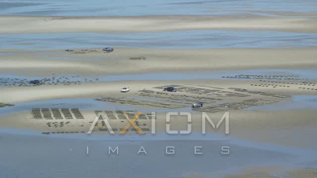 Flying by oyster farming, sand bars, Cape Cod, Dennis, Massachusetts Aerial Stock Footage | AX143_170