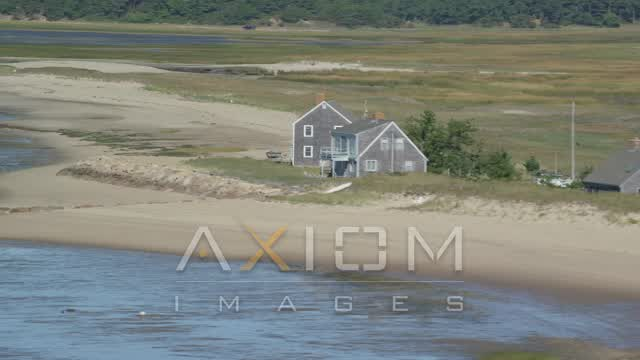 Flying by isolated beachfront homes, Cape Cod, Eastham, Massachusetts Aerial Stock Footage | AX143_189