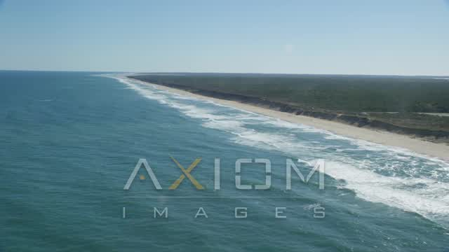 Flying by waves crashing onto beaches, Cape Cod, Eastham, Massachusetts Aerial Stock Footage | AX144_029